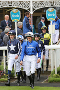 The jockeys enter the Parade Ring for the season's opening race and fixture at the York Dante Meeting at York Racecourse, York, United Kingdom on 16 May 2018. Picture by Mick Atkins.