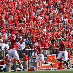 Sep 7, 2009; Piscataway, NJ, USA; Rutgers linebacker Damaso Munoz (17) leads the team onto the field prior to Rutgers 47-15 loss to Cincinnati in NCAA college football at Rutgers Stadium.