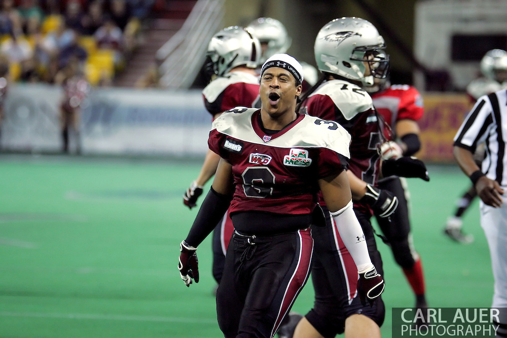 6-28-2007: Anchorage, AK - Thomas Ford Jr. (3) of the Wild reacts to having his helmet ripped off of his head during a first down run in the Alaska Wild 47 to 53 loss to the CenTex Barracudas at the Sullivan Arena.