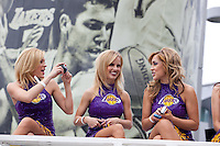 21 June 2010: The Laker Girls take pictures of themselves during the Los Angeles Lakers Championship Victory Parade on Figueroa BL. in Los Angeles, CA after the Lakers won the 2010 NBA Championship over the Boston Celtics in Game 7 of the NBA Finals.