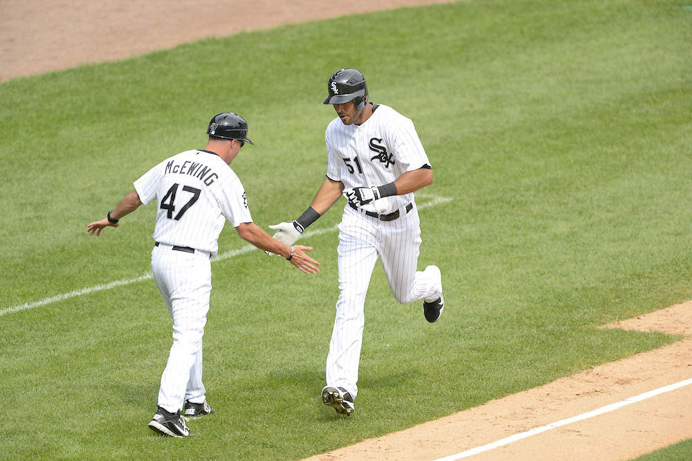CHICAGO - SEPTEMBER 05:  Alex Rios #51 celebrates with third base coach Joe McEwing #46 of the Chicago White Sox after hitting a two-run home run  against the Minnesota Twins on September 05, 2012 at U.S. Cellular Field in Chicago, Illinois.  The White Sox defeated the Twins 6-2.  (Photo by Ron Vesely)  Subject:    Alex Rios; Joe McEwing