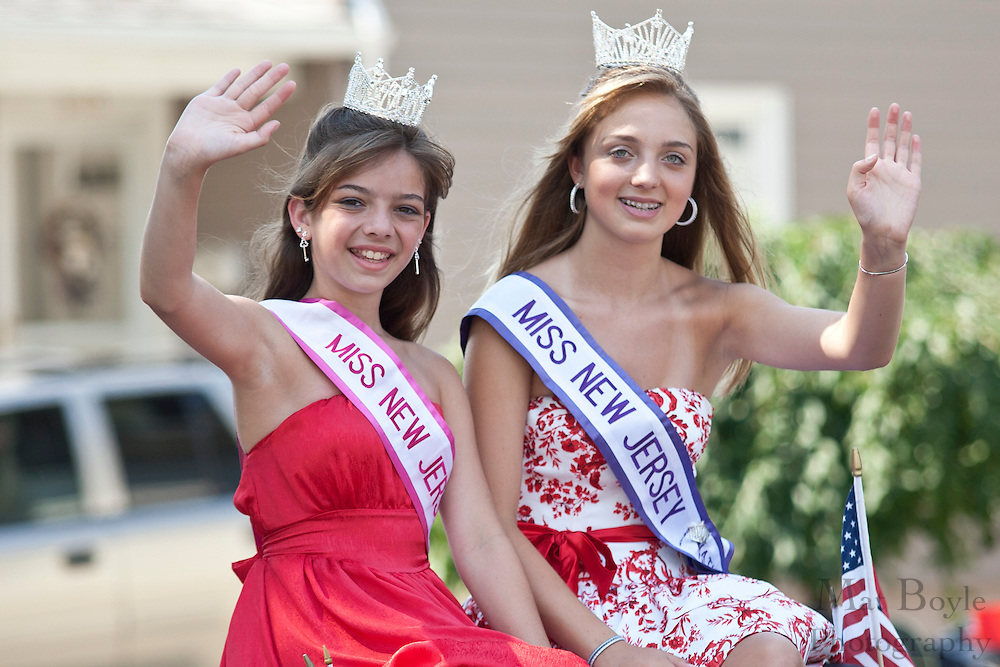 Miss New Jersey Junior National Teenager Mackenzie Olson (L) and Miss New jersey Preteen National Teenager Madison Welsh waves the the crowd at the 2010 Pitman NJ 4th of July Parade.