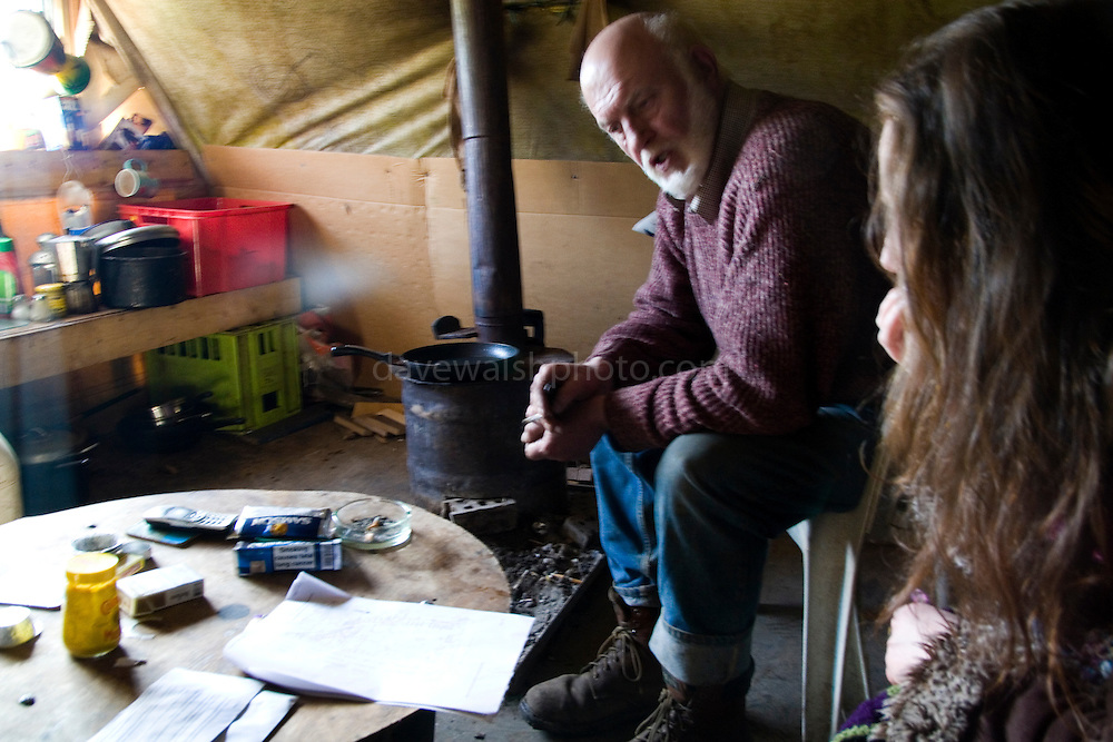 "Tara activist JP Fay in his hut at Tara. Fay, from Trim has been one of the long-term activists in fighting the M3 motorway's path through the Tara area. He and other proposed an alternative route that was turned down, and was one of the ""Tara Four"" jailed for refysing to bail conditions to stay away from the construction site..."
