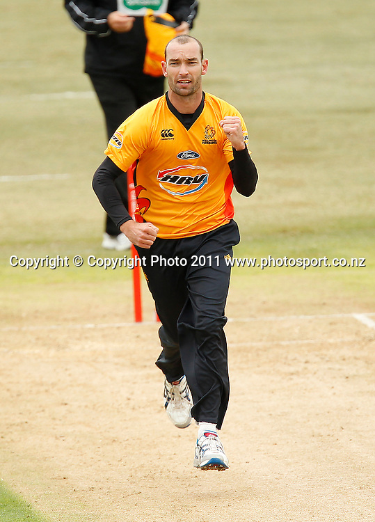 Andy McKay of the Firebirds celebrates a wicket during the HRV Cup Cricket Twenty-20,  Auckland Aces v Wellington Firebirds, Colin Maiden Park Auckland, Sunday 18 December 2011. Photo: Simon Watts/www.photosport.co.nz