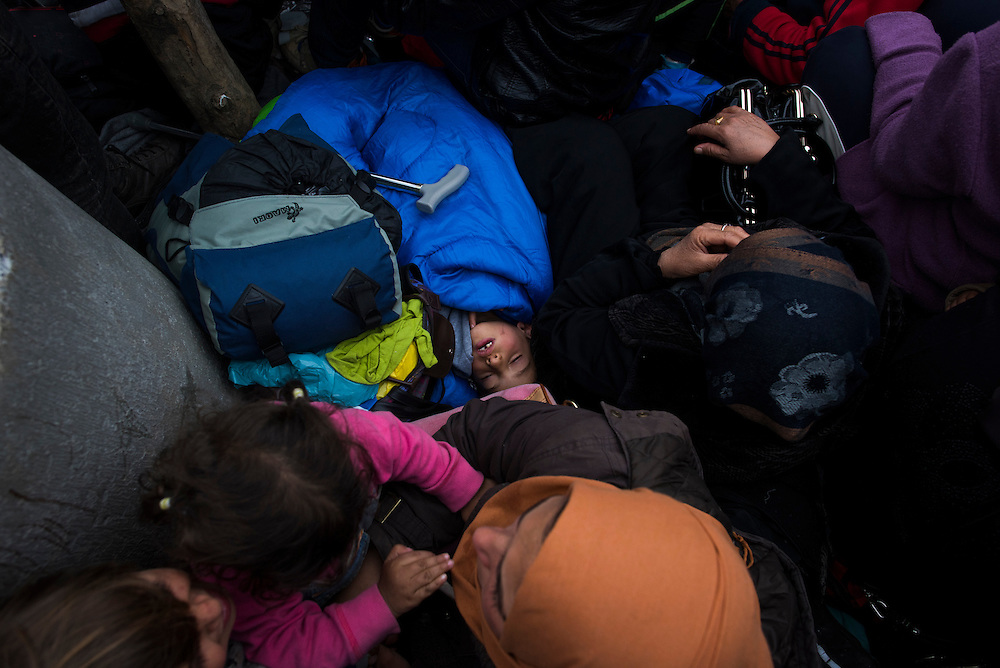 A Syrian family sits with hundreds of other refugees a few feet from the fence on the Macedonian (FYROM) border on March 6, 2016 in Idomeni, Greece. The family were a few of hundreds who were hoping to be part of the approximately 50 refugees who are let into Macedonia each day, they were not successful on this attempt.