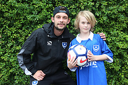 © Licensed to UK  News in Pictures.  Wednesday 12th  July 2017  Portsmouth,Hampshire. Pictured is  Louis Faith Pompey in the community (Portsmouth Football Club). With Ben Jackson presenting him with a premiere league football  that is to be released next year. The  group was answering a call for card after mum Lisa Jackson  posted on line asking the public to send lots of card for Ben's  birthday after party blanked a party that was organised last year for him.©UKNIP