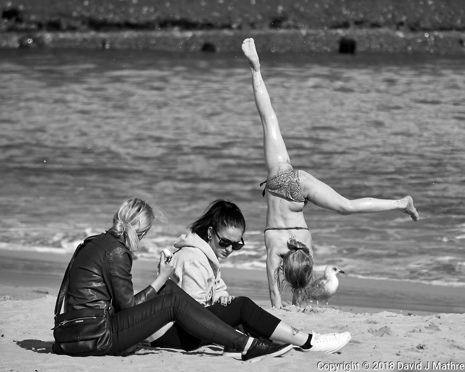 Acrobatics on the Beach. Afternoon Street Photography in Cascias. Image taken with a Nikon 1V3 camera and 70-300 mm VR telephoto zoom lens.