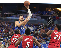 October 17, 2018 - Orlando, FL, USA - The Orlando Magic's Nikola Vucevic (9) shoots over Miami Heat defenders Rodney McGruder (17), Derrick Jones Jr. (5) and Hassan Whiteside (21) in the first half at the Amway Center in Orlando, Fla., on Wednesday, Oct. 17, 2018. (Credit Image: © Stephen M. Dowell/Orlando Sentinel/TNS via ZUMA Wire)