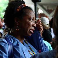 (Boston, MA - 7/12/17) Nurse Althea Robertson wipes away tears as she walks off the job to strike outside Tufts Medical Center, Wednesday, July 12, 2017. Staff photo by Angela Rowlings.