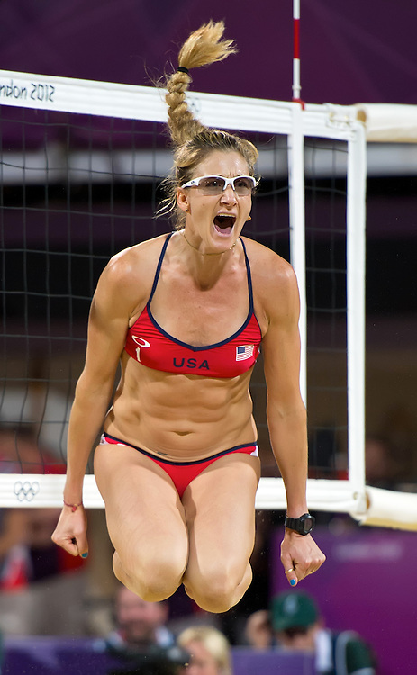 Kerri Walsh Jennings lept in the air after winning a point with her teammate Misty May-Treanor during their gold medal performance in women's beach volleyball at Horse Guard Parade during the 2012 Summer Olympic Games in London, England, Wednesday, August 8, 2012. (David Eulitt/Kansas City Star/MCT)