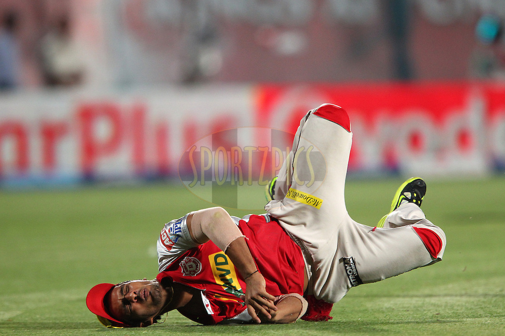 Mandeep Singh dives for the catch during match 67 of the Pepsi Indian Premier League between The Kings XI Punjab and the Delhi Daredevils held at the HPCA Stadium in Dharamsala, Himachal Pradesh, India on the on the 16th May 2013..Photo by Ron Gaunt-IPL-SPORTZPICS ..Use of this image is subject to the terms and conditions as outlined by the BCCI. These terms can be found by following this link:..http://www.sportzpics.co.za/image/I0000SoRagM2cIEc