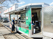 D'Angelo's Italian susage food trailer on Woodhaven Blvd in Queens. The trailer is from a company that builds trailers for race cars, and the rear ramp has been swapped for a solid back with a window, and a door has been added to the front of the trailer. The cusomization as a food trailer was by 800BuyCart.
