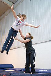 Sighted girl with teacher at trampolining youth group event run by NRSB,