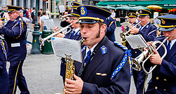 Bruges, Belgium - National Day - a marching band parades in the Grote Markt<br /> <br /> (c) Andrew Wilson | Edinburgh Elite media