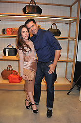TALLULAH HARLECH and ROLAND MOURET at a party to celebrate the launch of the Vogue Fashion's Night Out held at Mulberry, Bond Street, London on 6th September 2012.