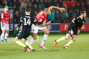 Macclesfield Town midfielder Connor Kirby challenges the opponent during the EFL Sky Bet League 2 match between Salford City and Macclesfield Town at the Peninsula Stadium, Salford, United Kingdom on 23 November 2019.