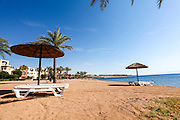 Jordan, Aqaba, Tala Bay beach with a parasol and sunning beds
