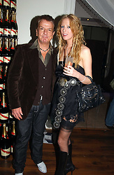 NICKY HASLAM and the hon.SOPHIA HESKETHat a party to celebrate the 4th anniversary of Quintessentially held at 11 Grosvenor Place, London  SW1 on 14th December 2004.<br /><br />NON EXCLUSIVE - WORLD RIGHTS
