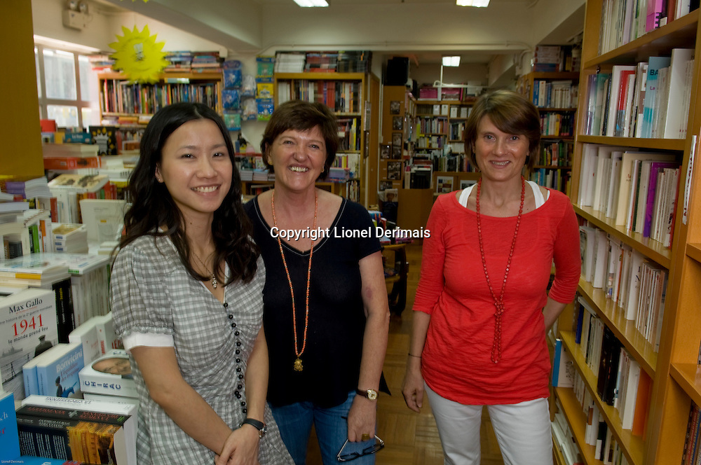 Madeline Progin (C) Parenthèses owner with Jenny (L) and Emmanuelle Le Moing (R) in the bookstore premises in Central, Hong Kong.