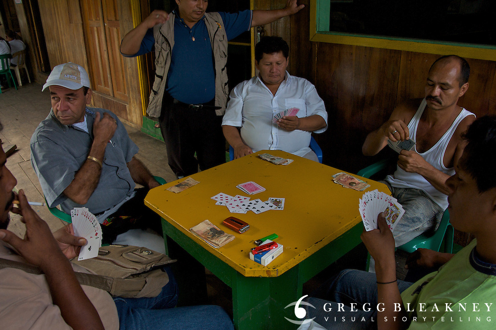 Men gamble at the warf - Puerto Narino - Amazonas - Colombia