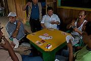 Men gamble at the warf - Puerto Narino - Amazonas - Colombia