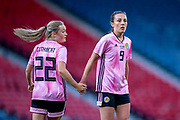 Erin Cuthbert (#22) of Scotland acknowledges an effort on goal from Caroline Weir (#9) of Scotland during the International Friendly match between Scotland Women and Jamaica Women at Hampden Park, Glasgow, United Kingdom on 28 May 2019.
