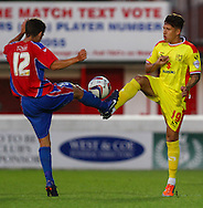 Frankie Raymond of Dagenham and Redbridge and Tom Hitchcock of Milton Keynes Dons battle for the ball during the Pre Season Friendly match at the London Borough of Barking and Dagenham Stadium, London<br /> Picture by David Horn/Focus Images Ltd +44 7545 970036<br /> 22/07/2014