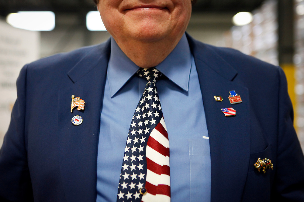 BUZZ ANDERSON poses for a portrait wearing his American Flag tie and Iowa lapel pins during a campaign event for Republican presidential candidate Mitt Romney at the Diamond V plant to gain support in the Iowa Caucuses on Friday, December 9, 2011 in Cedar Rapids, Iowa.
