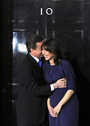 © under license to London News Pictures. LONDON. 05/05/2011. One year on since the last General Election. FILE PICTURE DATED.11/05/10. David Cameron hugs his wife Samantha on the steps of Number 10 Downing Street after becoming British Prime Minister. British Prime Minister Gordon Brown has resigned his position and David Cameron has become the new British Prime Minister on May 11, 2010. The Conservative and Liberal Democrats are to form a coalition government after five days of negotiation. Photo credit should read Stephen Simpson/LNP