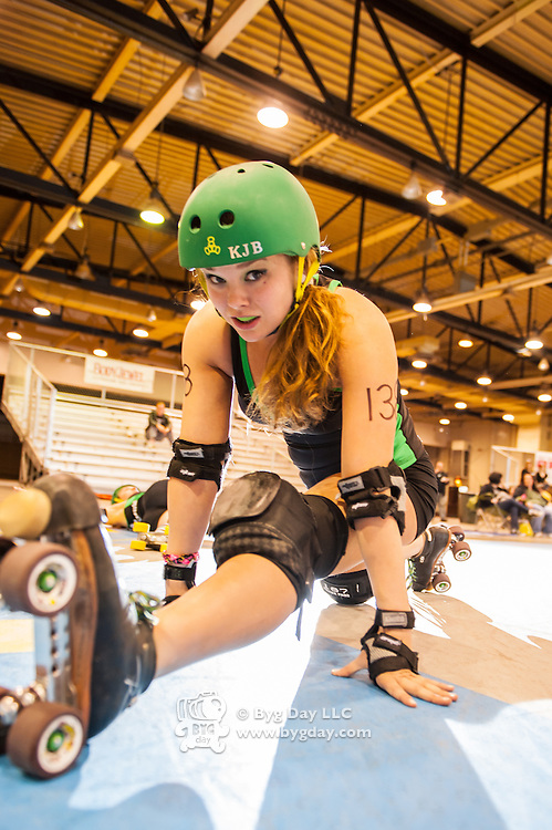 Pearl Rogi #139 stretching before the Columbus, OH - Ohio Roller Girls, Gang Green bout starts. ..Pittsburgh, PA, Steel Hurtin' VS. the Ohio Roller Girls All Stars..Pittsburg PA Steel Beamers VS. Ohio Roller Girls Gang Green ..6 April 2013: at Louche Building - Ohio Expo Center in Columbus, Ohio. Dorn Byg/Byg Day LLC