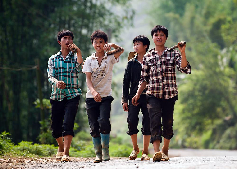 Boys return from the fields in Sapa, Vietnam.