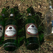 SANTO DOMINGO, DOMINICAN REPUBLIC-DECEMBER 3, 2014: Empty bottles of Presidente and Bohemia beers litter the grounds following an evening of socializing in Santo Domingo's Zona Colonial (Colonial Zone). Story on tourism to the Caribbean Island.  (Photo by Angel Valentin/Getty Images for Der Spiegel)