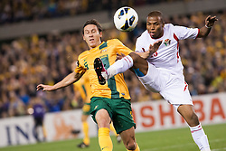 © Licensed to London News Pictures. 11/6/2013.  Australian Mark Milligan goes in for a challenge during the FIFA World Cup Qualifying match between Australia Vs Jordan at Docklands stadium, Melbourne, Australia.. Photo credit : Asanka Brendon Ratnayake/LNP