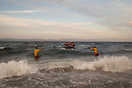 Spanish lifeguards guide a boat of migrants and refugees to land on the Greek island of Lesvos. As many migrants and refugees arrived in Europe in October 2015 as in the whole of 2014.
