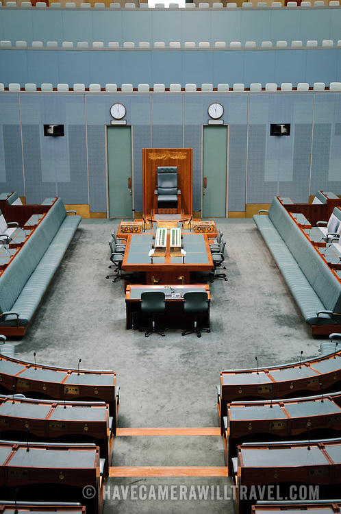 "In a reflection of the colour scheme of the British House of Commons, the House of Representatives is decorated in green. However, the colour is muted to suggest the colour of eucalyptus leaves.Parliament House is the meeting place of the Parliament of Australia. It is located in Canberra, the capital of Australia. It was opened on 9 May 1988 by Queen Elizabeth II, Queen of Australia.[1] Its construction cost was over $1.1 billion. At the time of its construction it was the most expensive building in the Southern Hemisphere. Prior to 1988, the Parliament of Australia met in the Provisional Parliament House, which is now known as ""Old Parliament House""."