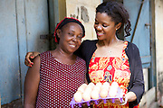 Njideka Harry (right), director of Youth for Technology pictured here with Ijeoma.<br /> <br /> Ijeoma Ewurum used to keep chickens as a hobby but when she retired from her teaching career she set it up as a larger business. <br /> <br /> She attended a business training workshop with Youth for Technology and signed up to receive Business SMS support.<br /> <br /> The main examples of success and impact from the SMS are around innovation and improving product quality; as a result she invested in new feed and vitamins and now has bigger and better eggs and heavier healthier birds. <br /> <br /> What she valued most from the training was learning about capital – she has not heard that word before but now understands the need to reinvest in your business. From the face to face she also valued meeting other women who offered advice.