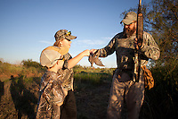 DOVE HUNTER WITH A HARVESTED MOURNING DOVE