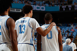 CHAPEL HILL, NC - FEBRUARY 05: Cameron Johnson #13 hugs teammate Seventh Woods #0 of the North Carolina Tar Heels plays during a game against the North Carolina State Wolfpack on February 05, 2019 at the Dean Smith Center in Chapel Hill, North Carolina. North Carolina won 113-96. North Carolina wore retro uniforms to honor the 50th anniversary of the 1967-69 team. (Photo by Peyton Williams/UNC/Getty Images) *** Local Caption *** Cameron Johnson;Seventh Woods