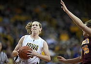 February 18, 2010: Iowa forward Kelly Krei (20) drives to the basket during the second half of the NCAA women's basketball game at Carver-Hawkeye Arena in Iowa City, Iowa on February 18, 2010. Iowa defeated Minnesota 75-54.