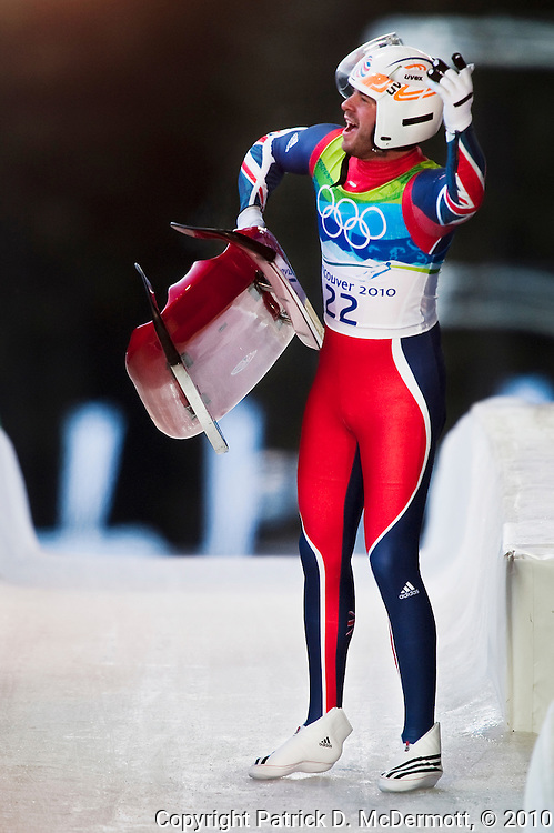 A. J. Rosen, GBR, celebrates after finishing his fourth run of the Men's Single Luge competition during the 2010 Vancouver Winter Olympics at the Whistler Sliding Centre in Whistler, British Columbia, Sunday, Feb. 14, 2010.