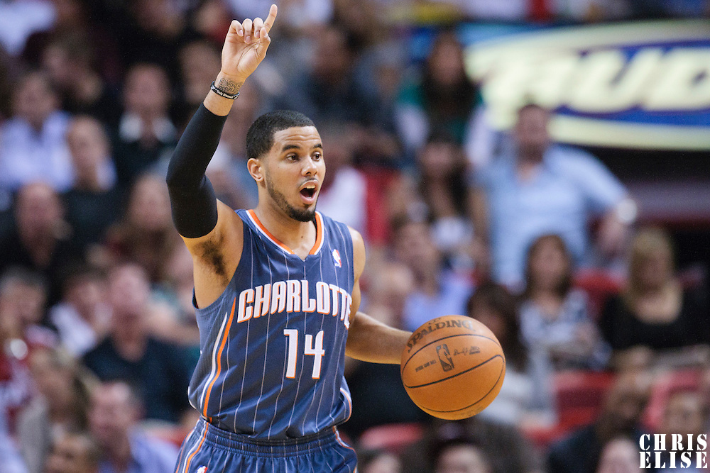 19 November 2010: Charlotte Bobcats' point guard #14 D.J. Augustin calls a play during the Miami Heat 95-87 victory over the Charlotte Bobcats at the AmericanAirlines Arena, Miami, Florida, USA.