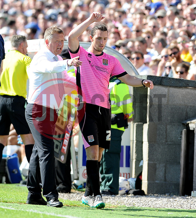 Northampton Town Manager Chris Wilder ushers John-Joe O'Toole of Northampton Town back to the bench - Mandatory byline: Neil Brookman/JMP - 07966386802 - 08/08/2015 - FOOTBALL - Memorial Stadium -Bristol,England - Bristol Rovers v Northampton Town - Sky Bet League Two