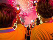 05 DECEMBER 2014 - BANGKOK, THAILAND: Thais use their smart phones to record video of a fireworks show the closed the King's Birthday on Sanam Luang in Bangkok. Thais marked the 87th birthday of Bhumibol Adulyadej, the King of Thailand,  Friday. The King was born on December 5, 1927, in Cambridge, Massachusetts. The family was in the United States because his father, Prince Mahidol, was studying Public Health at Harvard University. He has reigned since 1946 and is the world's currently reigning longest serving monarch and the longest serving monarch in Thai history. Bhumibol, who is in poor health, is revered by the Thai people. His birthday is a national holiday and is also celebrated as Father's Day. He is currently hospitalized in Siriraj Hospital, recovering from a series of health setbacks.     PHOTO BY JACK KURTZ