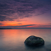 Rounded stone in the sea