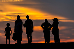© Licensed to London News Pictures. 01/08/2018. LONDON, UK. People watch a glorious sunset from Northala Fields in Northolt, west London, after a warm day.  The forecast is for temperatures rising to the 30s C by the weekend.    Photo credit: Stephen Chung/LNP