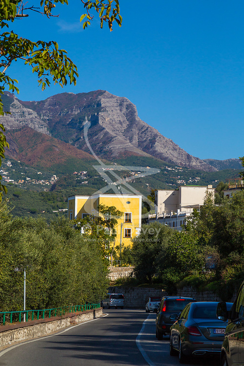 Sorrento, Italy, September 17 2017. An ochre coloured villa on the Corsa Caulino near Seiano, southern Italy contrasts with the nearby Monte Latarri mountains and blue sky. © Paul Davey