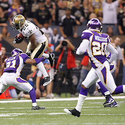 September 9, 2010; New Orleans, LA, USA;  New Orleans Saints running back Reggie Bush (25) leaps over Minnesota Vikings cornerback Chris Cook (31)during first half of the NFL Kickoff season opener at the Louisiana Superdome. Mandatory Credit: Derick E. Hingle