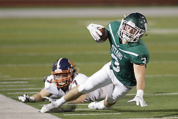 {BLOOMINGTON, IL:  Bryce Dooley has his run ended by Corey Kennedy during a college football game between the IWU Titans  and the Wheaton Thunder on September 15 2018 at Wilder Field in Tucci Stadium in Bloomington, IL. (Photo by Alan Look)