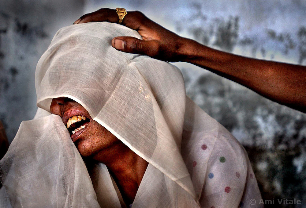 Shaikh Kulsumbibi, 37, a Muslim whose village of Sardarpur was destroyed in a gruesome vengeance attack weeps as she seeks refuge in another village in India, March 3, 2002.  Hindus came in the middle of the night and massacred nearly every one of her neighbors and family living there in a strategically designed plan which involved flooding the exit and then electrocuting those who were not first killed by the firebombs and kerosene.