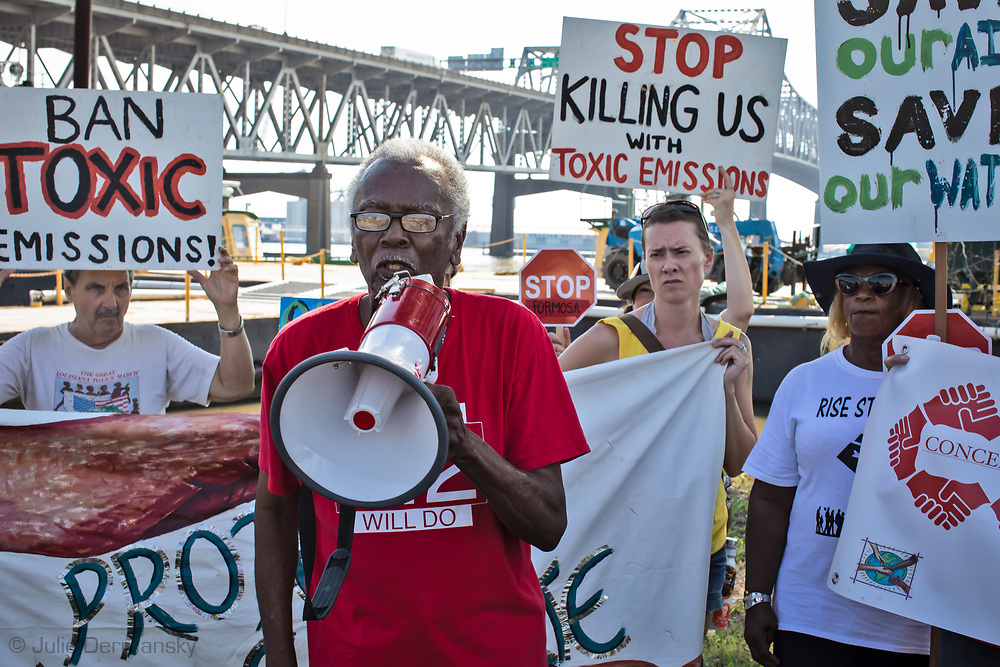 "Robert Taylor of CADA and supporters at the foot of the I-10 Bridge in Baton Rouge, Louisiana on the fourth day of the Coalition Against Death Alley's 5 day march. The Coalition Against Death Alley (CADA), is a group of Louisiana-based residents and members of various local and state organizations, is calling for a stop to the construction of new petrochemical plants and the passing of stricter regulations on existing industry in the area that include the groups RISE St. James, Justice and Beyond, the Louisiana Bucket Brigade, 350 New Orleans, and the Concerned Citizens of St. John. Louisiana's Cancer Alley, an 80-mile stretch along the Mississippi River, is also known as the ""Petrochemical Corridor,"" where there are over 100 petrochemical plants and refineries."